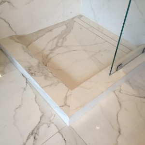 Groutless Shower Floor with Linear Drain in Calacatta Gold SlimSlab